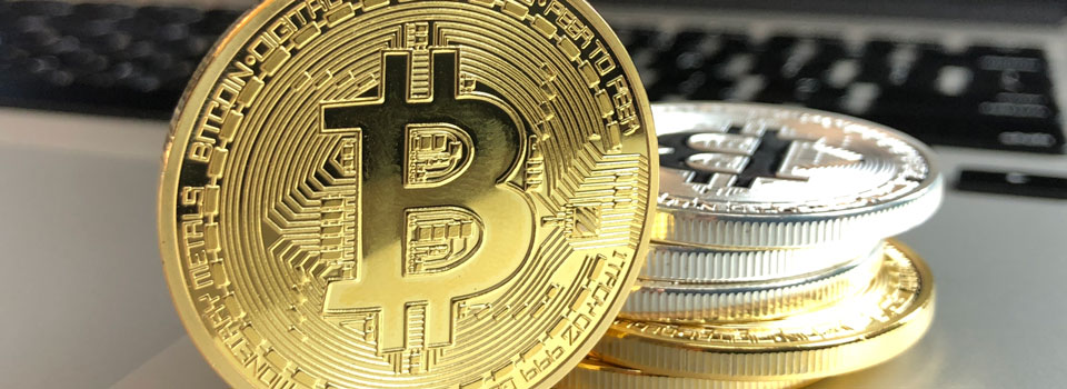 Bitcoin with laptop background